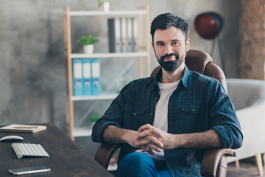 Photo portrait of young recruiter sitting in office on interview smiling thoughtful