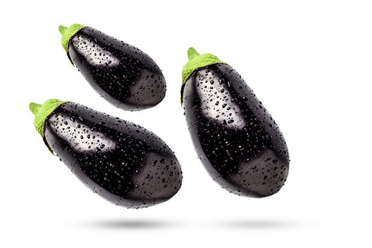 Eggplant in drops of water on a white background. Flatlay