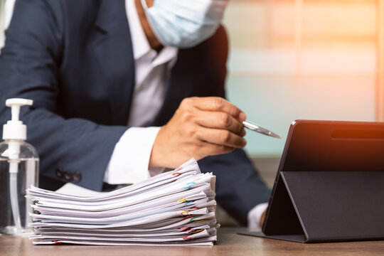 Document paper report with employees wearing mask