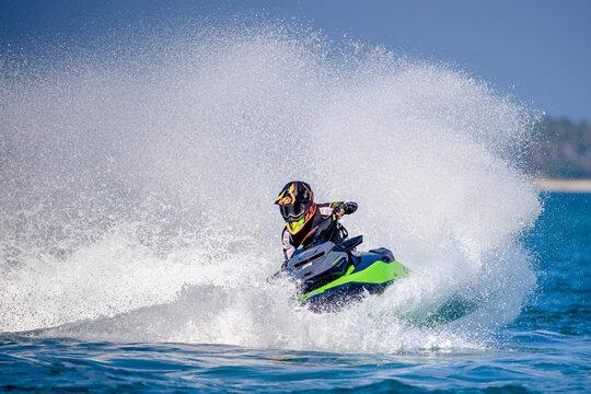 A man driving a jet ski
