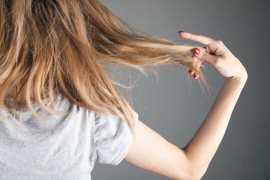 Woman hand in fragile hair