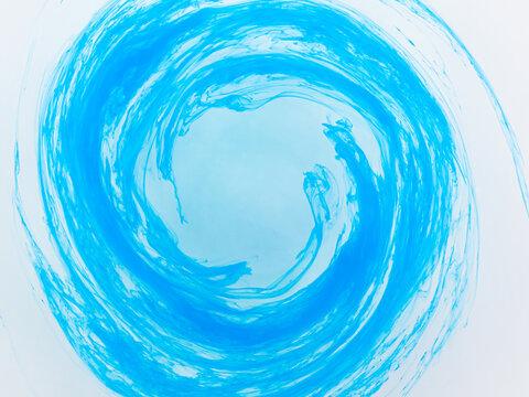 水中の絵の具 回転して輪になる青