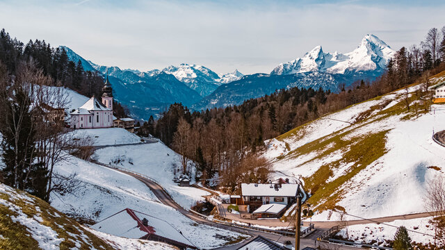 Beautiful winter view with the famous Watzmann summit and a church in the background at Maria Gern, Berchtesgaden, Bavaria, Germany