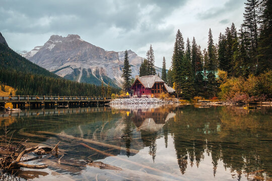 Scenery of wooden house with rocky mountains and cloudy blowing reflection on Emerald Lake at Yoho national park