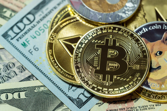 Dogecoin DOGE, bitcoin, Ethereum ETH, Binance Coin, included with Cryptocurrency coin  on stack 100 hundred new US dollar Money American Virtual blockchain technology future is money Close up concept.