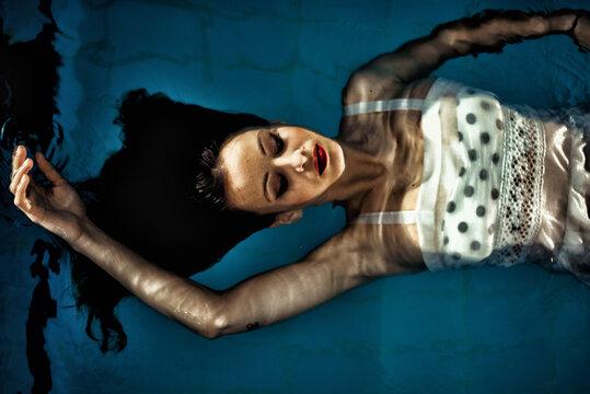 Female model posing in a pool