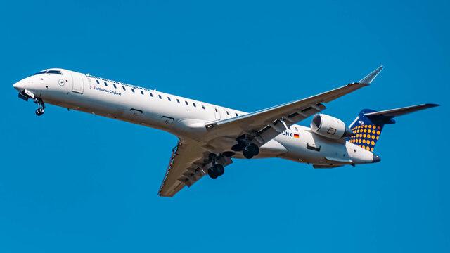 Lufthansa Bombardier CRJ9 (D-ACNX) approaching munich airport MUC on a sunny winter day
