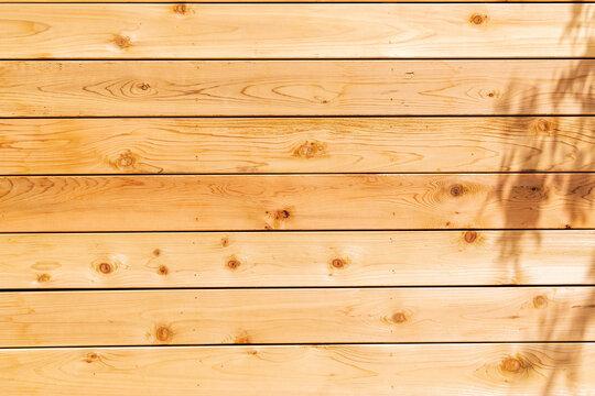 Fresh wood softwood wall made of horizontal boards.