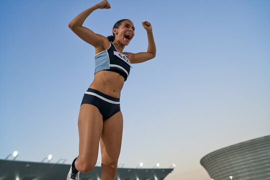 Excited track and field athlete celebrating victory