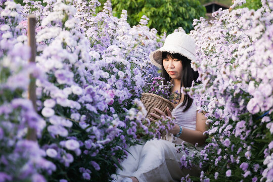 Woman Holding Flowers In Park