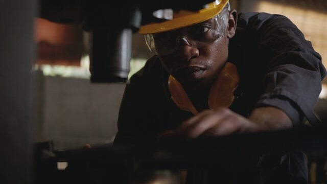 Portrait Of Man Working At Factory