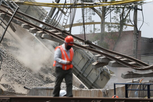 A view shows on a part of the damage caused by an accident where an overpass for a metro partially collapsed with train cars on it, in Mexico City