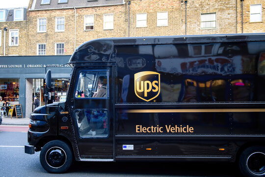 London, United Kingdom - March 9, 2017: Electric Vehicle UPS United Parcel Services postal delivery van driving on London street transporting letters documents internet orders and e-commerce goods