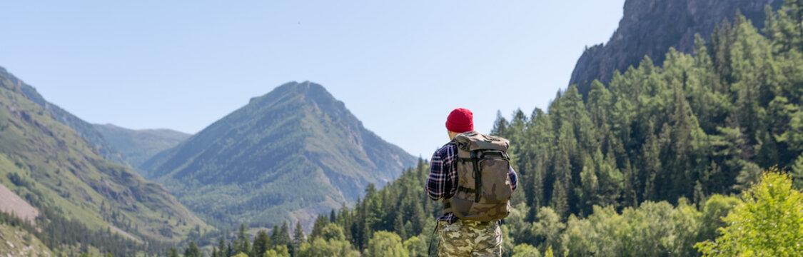 hiker men walking in the mountains