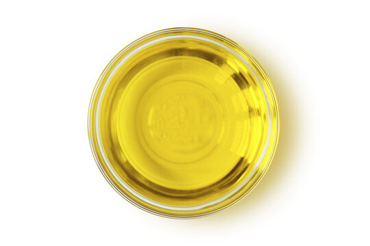 Argan oil in glass bowl on white background