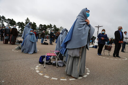 Pilgrims attend the 104th anniversary of the appearance of the Virgin Mary at the Catholic shrine of Fatima