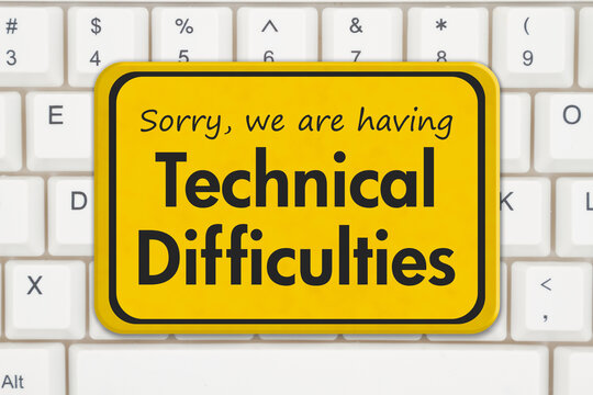 Technical Difficulties message on a white keyboard