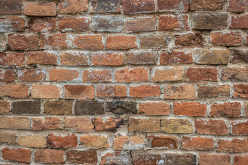 Old brick wall grouted with lime mortar