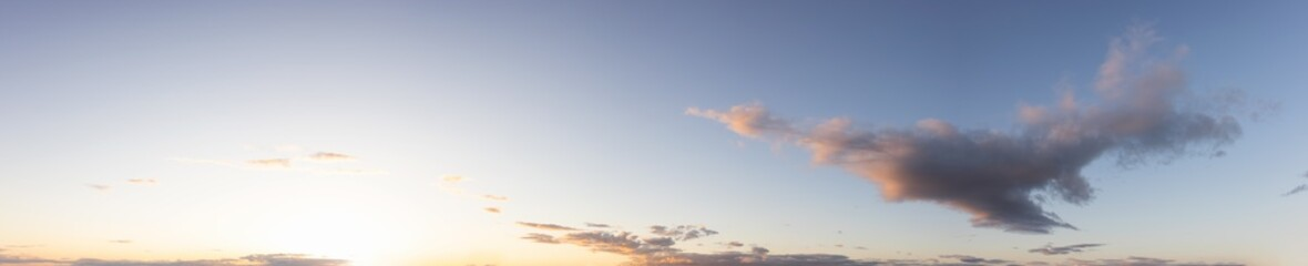 Panoramic View of Cloudscape with puffy sky and clear sunny sunlight during a colorful sunset or sunrise. Taken on the West Coast of British Columbia, Canada.