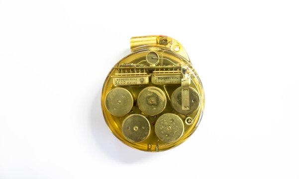 Omni-Stanicor Vintage Cardiac Pacer circa 1975. Implantable pacemaker, circular, transparent plastic encasing inner mechanics visible. Cardiology instrumentation