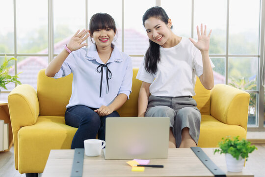 Young and beautiful Asain woman talk to someone on a notebook computer screen with hand sign, deaf language