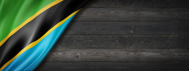 Obraz Tanzania flag on black wood wall banner - fototapety do salonu