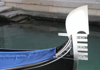 prow of the gondola with the characteristic shape that symbolizes the districts of the island of Venice