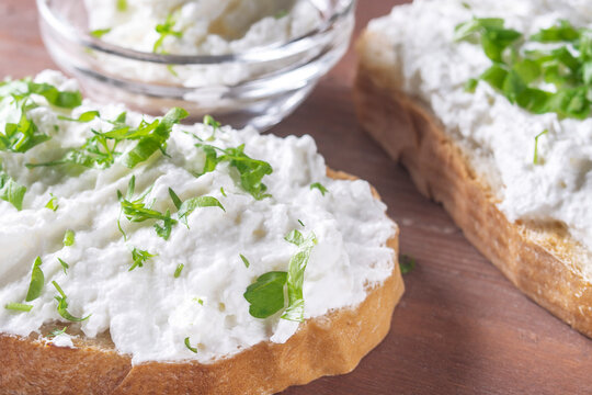 cottage cheese sprinkled with herbs on a slice of bread