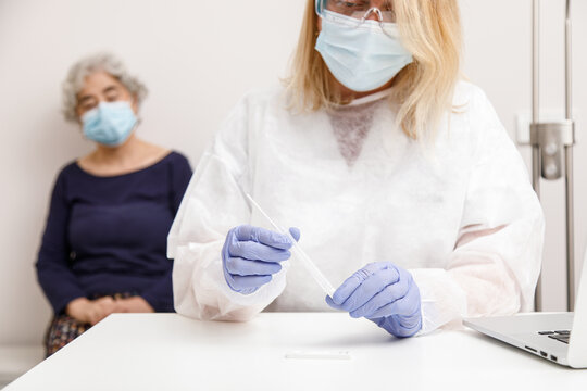 Female doctor preparing to do a pcr test