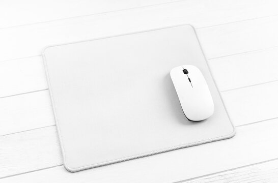 Computer mouse on white mouse pad