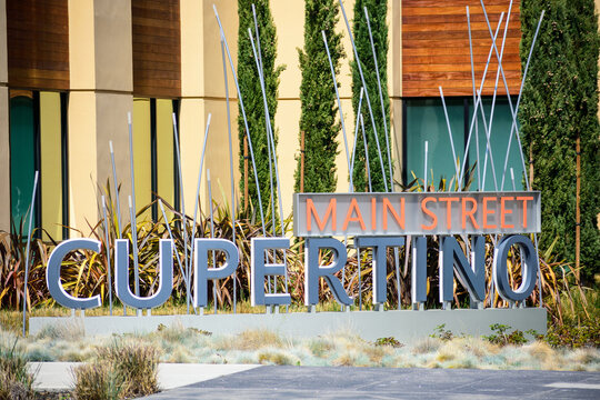 Main Street Cupertino sign advertises modern outdoor shopping center and mixed-use neighborhood located on Stevens Creek Boulevard. - Cupertino, California, USA - 2021