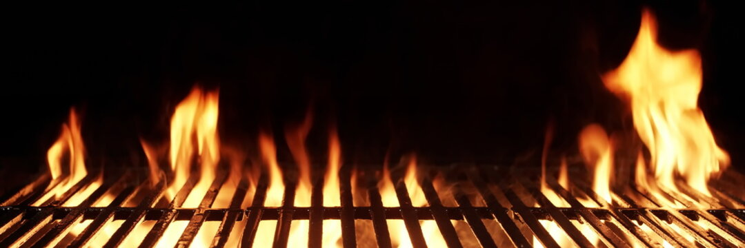 Barbecue Fire Grill Isolated On Black Background. BBQ Flaming Charcoal Grill Isolated. Hot Barbeque Charcoal Cast Iron Grill With Bright Flames Of Fire. Abstract Panoramic Grill Wide Banner.