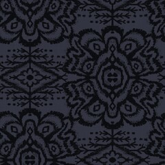 Seamless almost black tribal ethnic rug motif pattern. High quality illustration. Hand drawn symmetric native style design in dark gray and black with texture. Old artisan textile seamless pattern.