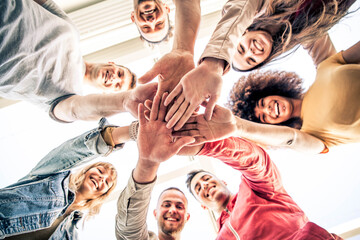 Obraz Young happy people stacking hands together outcoor - Community of multiracial international people supporting each other - Diverse culture - fototapety do salonu