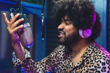 Fototapeta Young afro singer recording a new song album inside music production studio obraz