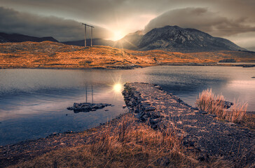 Beautiful morning cloudy sunrise scenery at Derryclare lake in Athry, County Galway, Ireland