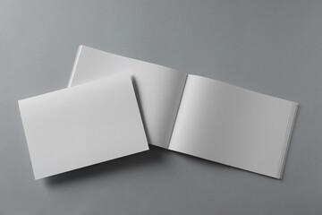 Fototapeta Blank brochures on light grey background, flat lay obraz