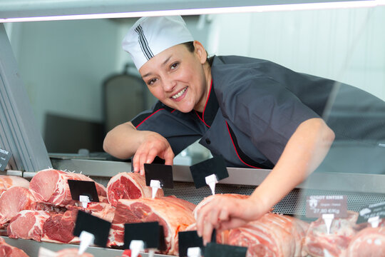 female butcher posing and smiling