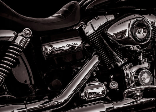 Closeup Harley Davidson Super Glide rich deep black and white.