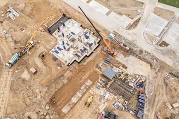 construction site, aerial view. building concrete foundation for new multistory house - pouring a wet concrete into floor slab. - fototapety na wymiar