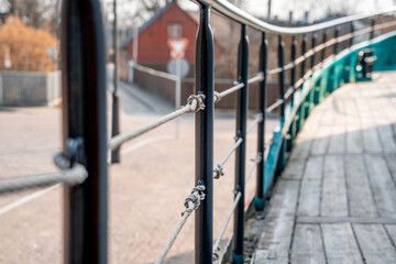 Fototapeta premium decorative rope fence with metal railings and ropes stretched between them. ship fence