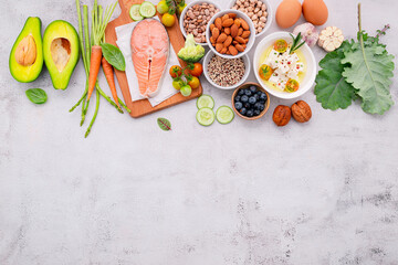 Ketogenic low carbs diet concept. Ingredients for healthy foods selection set up on white concrete background.