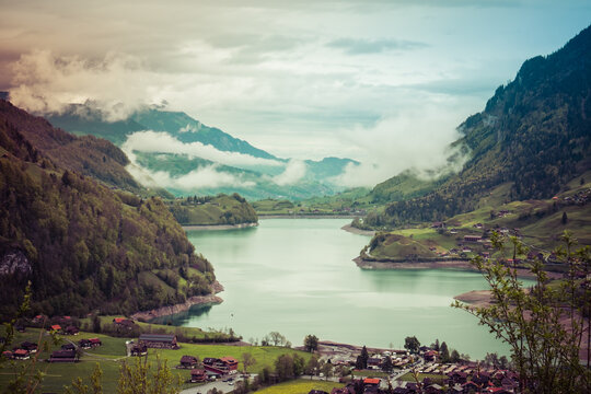 Landscape view of the Brünig valley, with lake and mountains in the background, shot in Brünig, Obwald, Switzerland