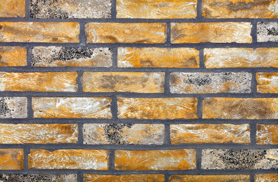 The texture of the old wall is lined with straight rows of old bricks and worn out with gray cement joints.