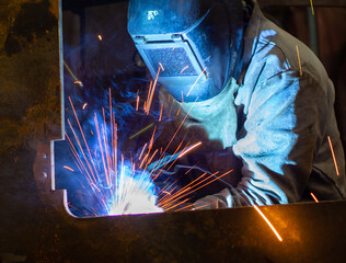 a welder in a mask