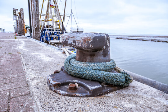 Thick rope in the harbor to secure a ship