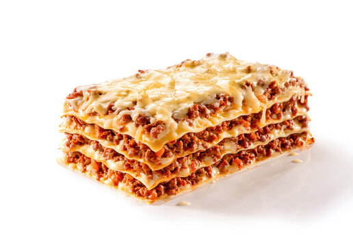 slice of lasagna with melted cheese on top and minced meat filling close-up isolated on white background with shadow