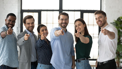 Fototapeta We need you. Happy confident professional group pointing finger at camera. Diverse millennial team of employees making choice, offering job, searching candidates for hiring. Head shot photo portrait obraz