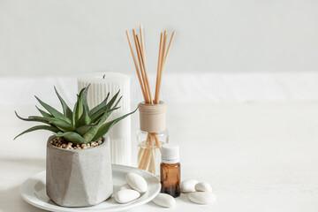 Obraz Minimalistic composition with aroma sticks and aroma oil copy space. - fototapety do salonu