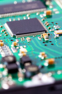 Macro shot of computer circuit board with microchip and other components